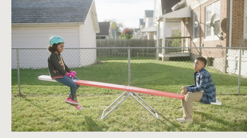 Children on teeter-totter.